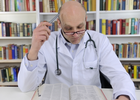 adverse reaction: Doctor looking up information on medicine in book