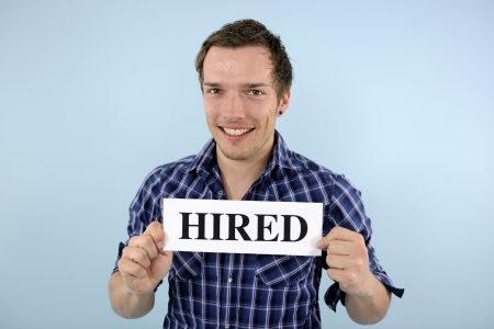 happy young man holding hired sign photo