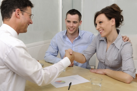 financial guidance: Financial advisor or lawyer giving advice to happy couple