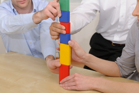 Business teamwork concept: Building tower of blocks photo