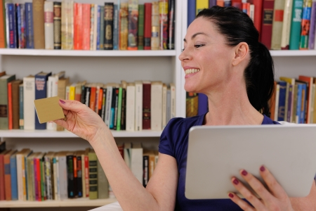 mature woman shopping online with digital pad photo