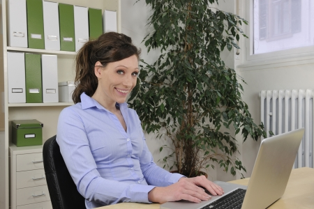 green office: business woman working at office photo