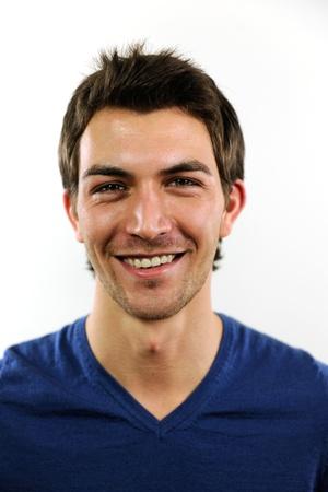 pasaportes: retrato de un joven casual en el fondo blanco Foto de archivo