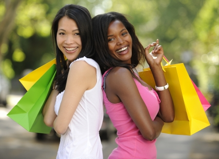 happy multiethnic friends with shopping bags photo