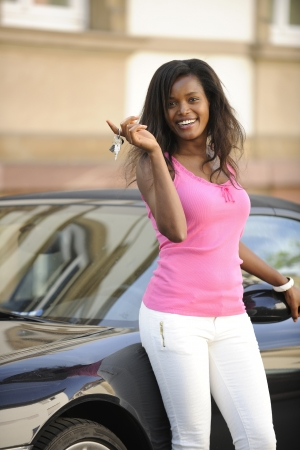 african american  woman with her new car showing keys Stock Photo