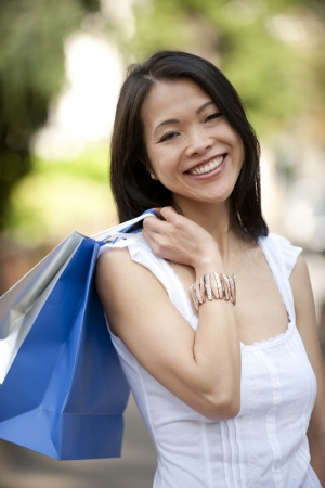 happy japanese woman with shopping bags photo