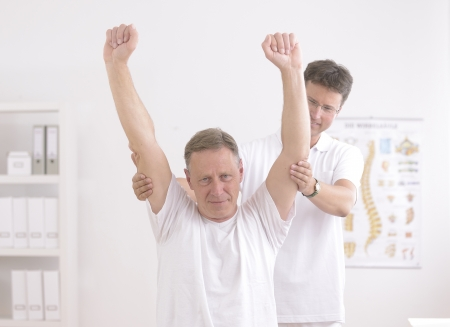 body check: Physiotherapy  Senior man and physiotherapist at office Stock Photo