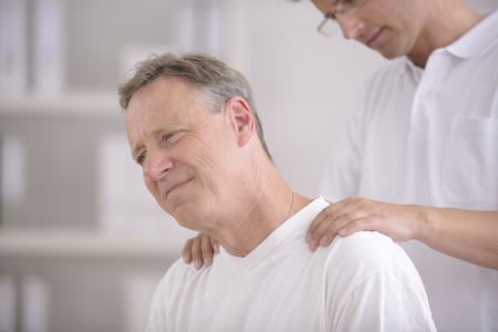 Physiotherapy  Physiotherapist massaging patient at office Stock Photo - 14004427