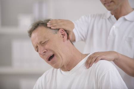 Chiropractic  Chiropractor doing neck adjustment photo