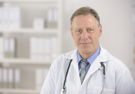 portait: Portait of a mature male doctor at office Stock Photo