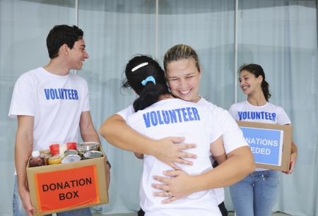 volunteering: happy volunteer group with food donation boxes  Stock Photo
