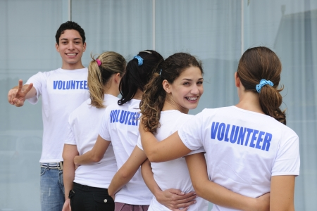 row of happy and diverse volunteer group smiling photo