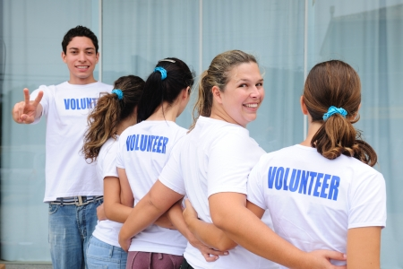 charitable: row of happy and diverse volunteer group smiling