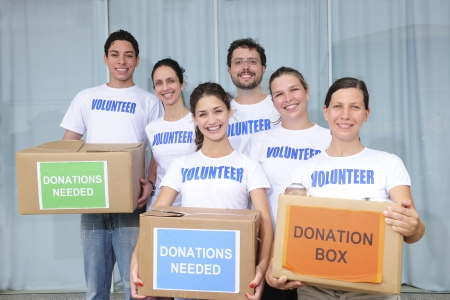donations: diverse volunteer group with food donation boxes  Stock Photo