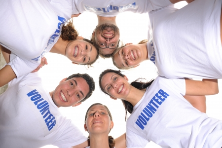 volunteering: Happy volunteer group forming a circle Stock Photo