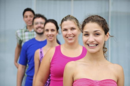happy and diverse group of casual real people, teenage girl in front photo