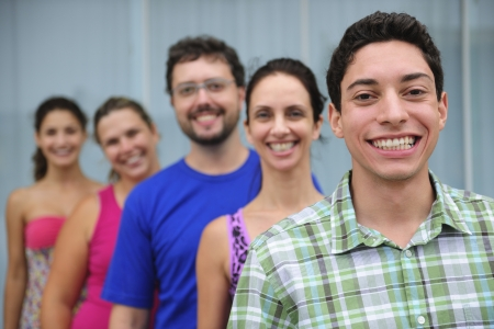 happy and diverse group of casual real people, young man in front photo