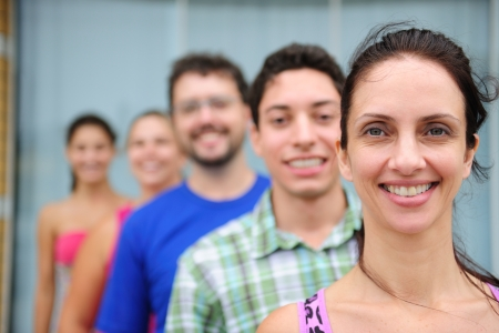 happy and diverse group of casual real people, mid adult woman in front photo
