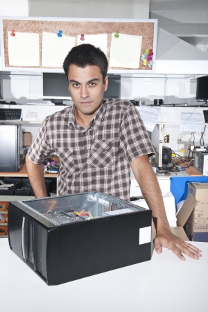 Small business:  owner of a computer repair store Stock Photo - 14712649