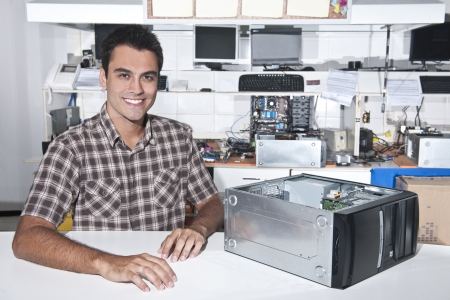 Small business:  owner of a computer repair store Stock Photo - 14712640