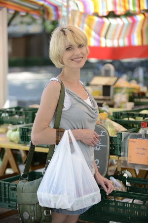 Happy woman buying vegetables at farmer's market Stock Photo - 14712687