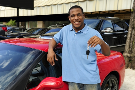 happy man showing key of new red sports car Stock Photo - 14712575