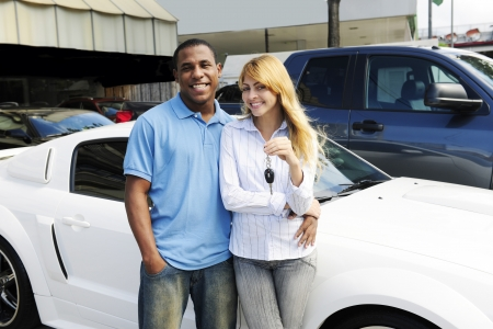 happy multiethnic couple buying a new car photo