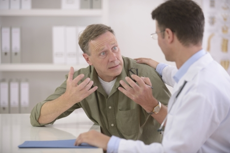 psychotherapy: Doctor talking to frightened or anxious patient