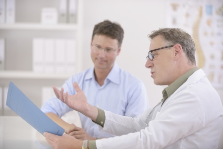 Healthcare: Doctor and patient discussing blood-test results Stock Photo