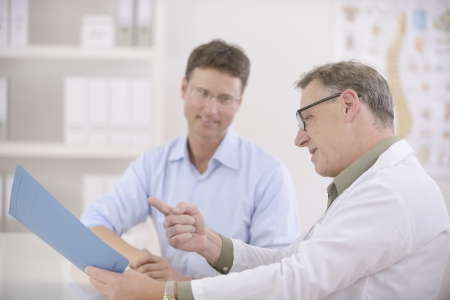 Healthcare: Doctor and patient discussing blood-test results photo