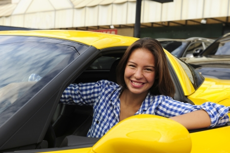 happy woman sitting inside of her new yellow sports car Stock Photo - 14712532