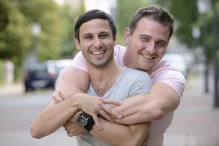 gay men: Portrait of a happy couple outdoors