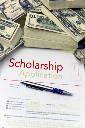 Scholarship application form and dollar bills photo