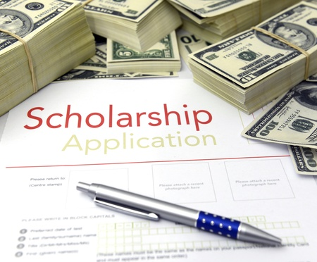 scholarship: Scholarship application form and dollar bills