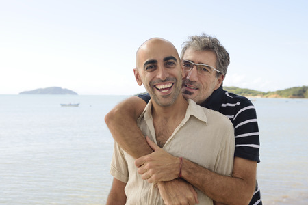 gay men: Middle aged couple gay couple on vacation