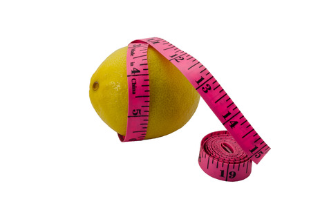 excess weight: The lemon twisted with tape measure isolated on white background. A concept  a fruit diet and fight against excess weight.