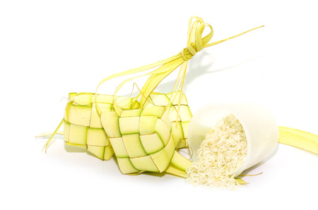 Ketupat and rice on white background. Ketupat is traditional food in Malaysia
