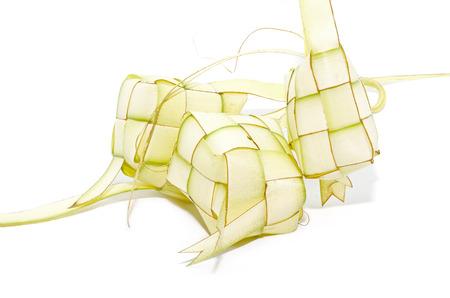 hari raya aidilfitri: Ketupat on white background. Ketupat is traditional food in Malaysia Stock Photo