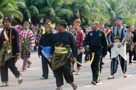 participate: KUANTAN-AUG 31:Malaysians participate in National Day parade, celebrating the 58th anniversary of independence on August 31, 2015 in Kuantan, Pahang, Malaysia. Editorial