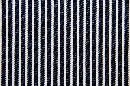 Navy blue and white striped denim texture