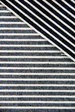 Overlapped navy blue and white striped denim texture  Stock Photo