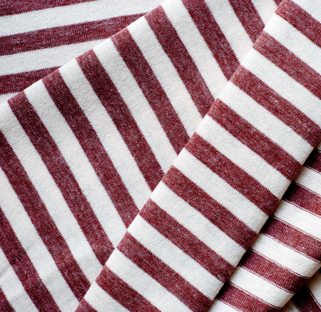 Folded brown striped cotton texture