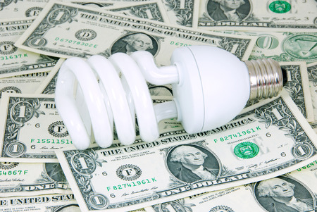 Saving energy bulb on money for the saving energy expense concept  photo