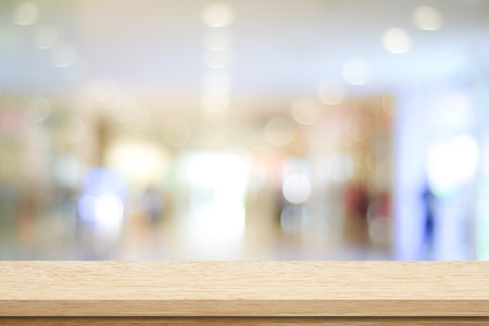 Empty table and blurred store bokeh background, product display