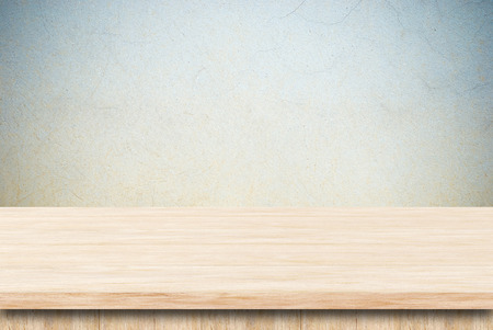 empty board: Empty wooden table over grunge cement wall. Stock Photo