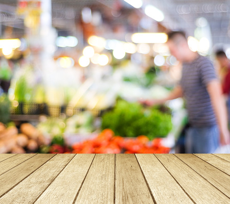 Perspective wood over blur supermarket with bokeh background