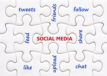 Social media words on white jigsaw puzzle background Stock Photo