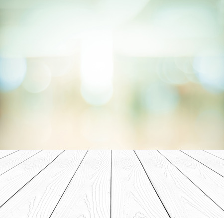 empty space: Perspective white wood and blurred store with bokeh background