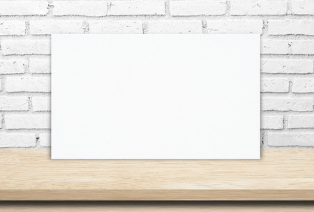 Blank paper poster and brick wall background, template photo