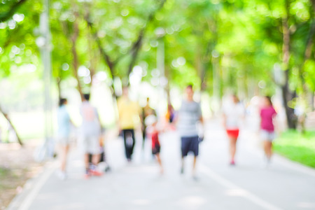 walking in park: Blurred background of people activities in park with bokeh, spring and summer season Stock Photo